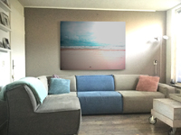 Living Room with a Large Aluminum Print of a sea view by Go van Kampen above a big sofa